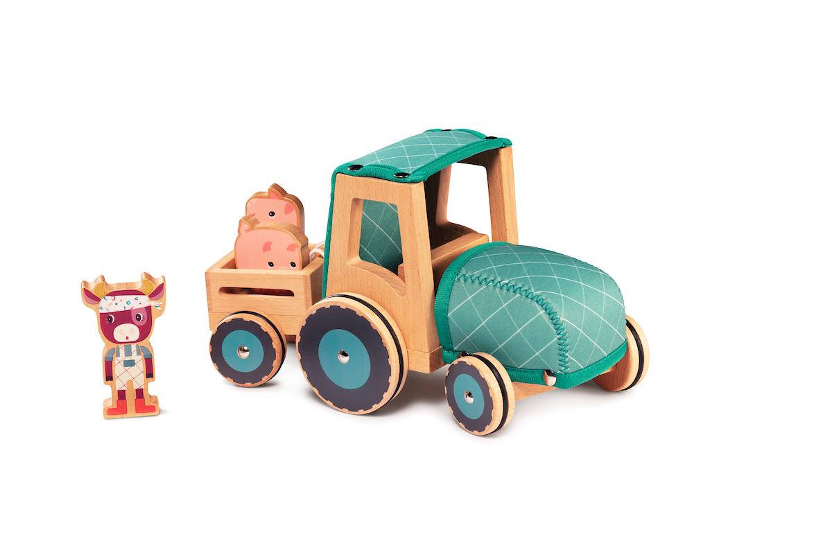 Traktor mit Anhänger aus Holz und Neopren Rosalie Kuh