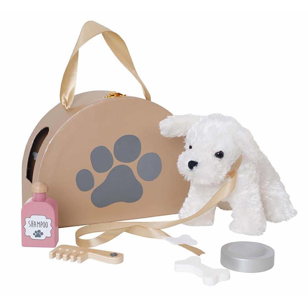 Hund mit Tasche und Zubehör